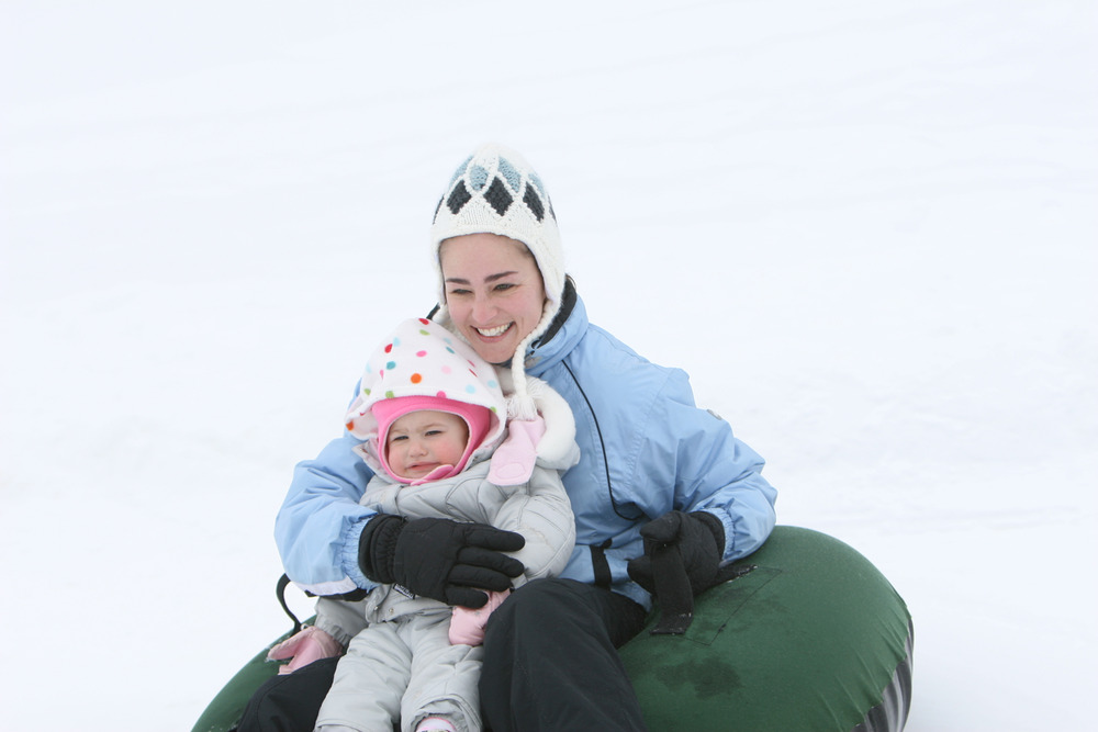 A mother and her child go tubing in Boyne Highlands Resort, Michigan