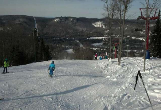 Skied today! Opening Day, main hill open with snowmaking. Some ice spots but atleast we skied. Base is coming along...