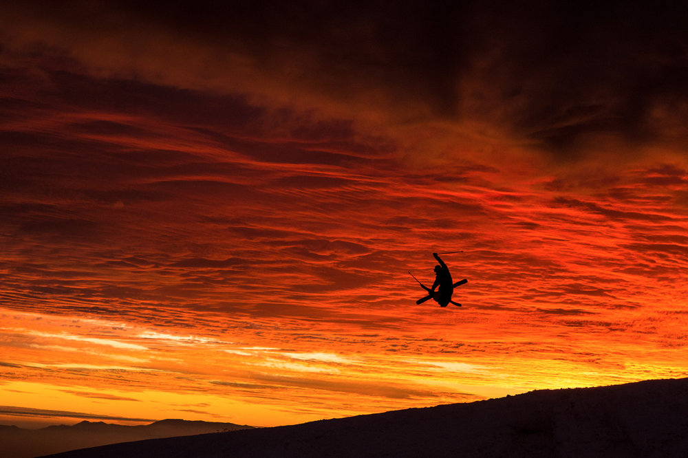 Karl Fostvedt catching some air high in the andes against an incredible La Parva sunset