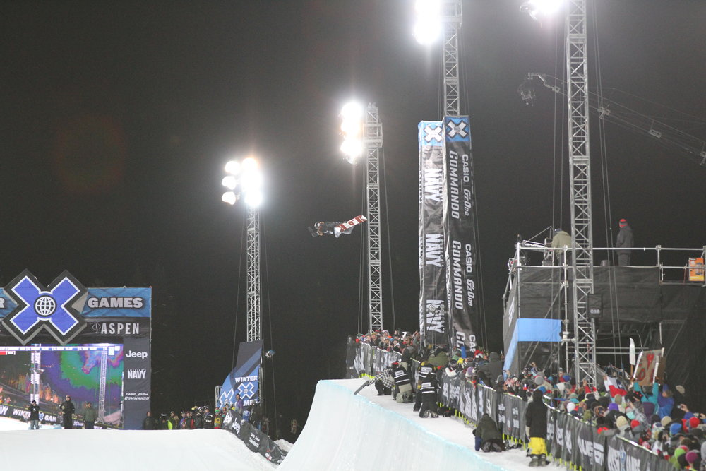 Shaun White gets high in his first run in the SuperPipe. Photo by Tim Shisler.