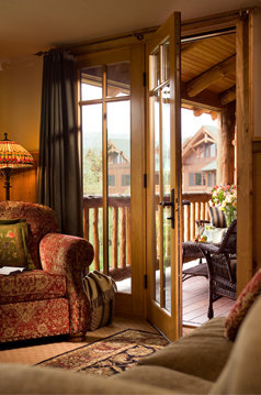 Whiteface Lodge rooms feature a vast balcony suitable enough for a small cocktail party.