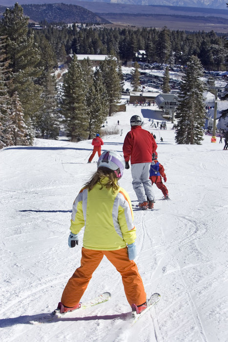 A young skier getting lessons in Mammoth Mountain, California
