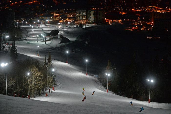 Skiers and riders loving the new night skiing. - ©Larry Pierce