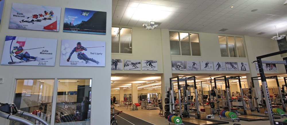 Oversized posters celebrating past Olympic medalists line the interior walls of the Center of Excellence, inspiring athletes to train harder. Photo by Tim Shisler.