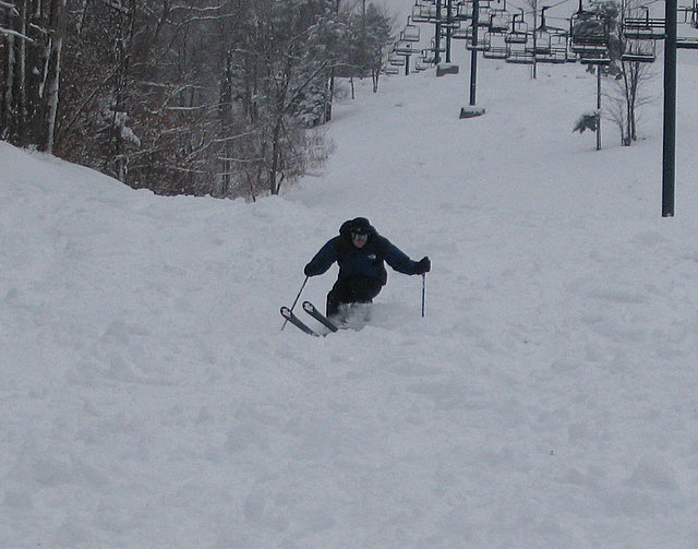 A skier goes by the chair lifts at Ragged Mountain, New Hampshire
