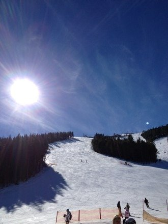 Sunny and warm, good skiing conditions early in the morning till 1-2 pm
