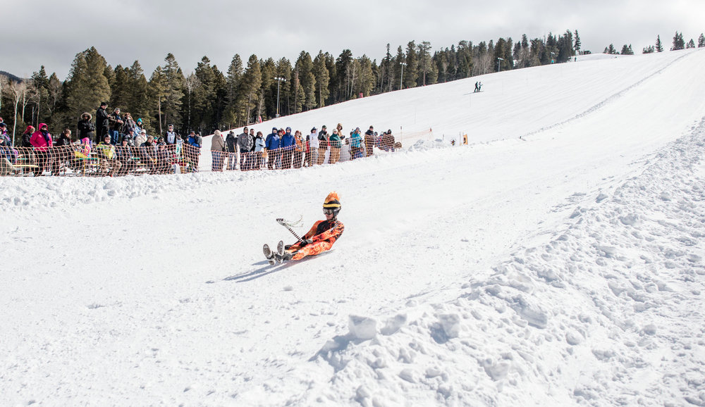Freshly waxed shovels are on course during Angel Fire's annual World Championship Shovel Race.   - ©Courtesy of Angel Fire Resort