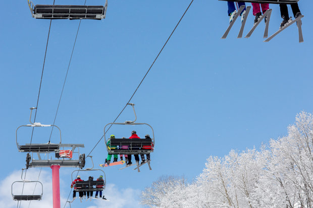 Blue sky, white trees, pink lift, at Shanty Creek