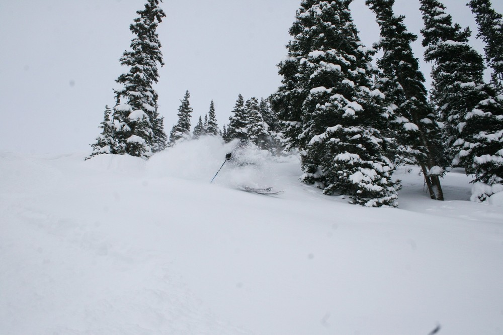 Skier blasting through powder at Copper Mountain, CO.