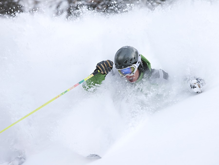 Telluride skier in deep powder.