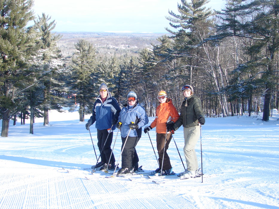 Four skiers pause for a photo at Pine Mtn, MI.