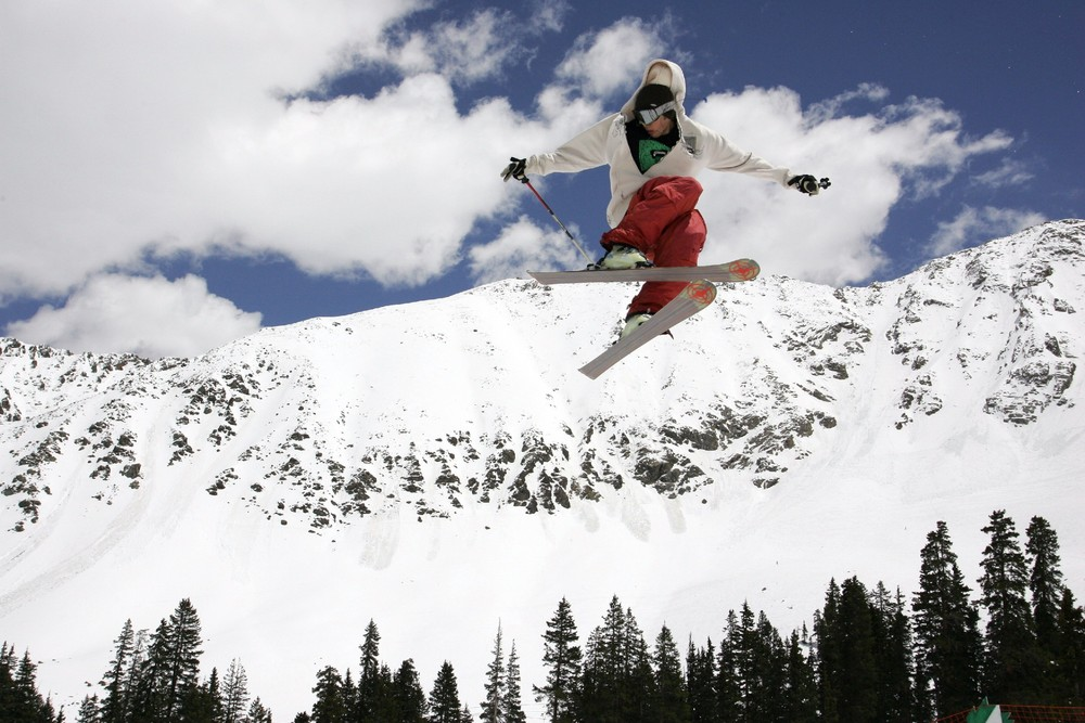 A skier catching air in Arapahoe Basin, CO.