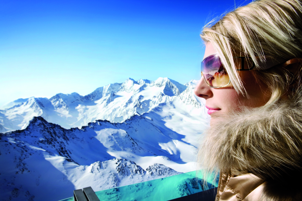 A woman surveying Obergurgl, AUT