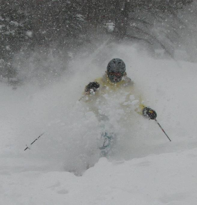 A skier crashing through powder at Solitude, UT