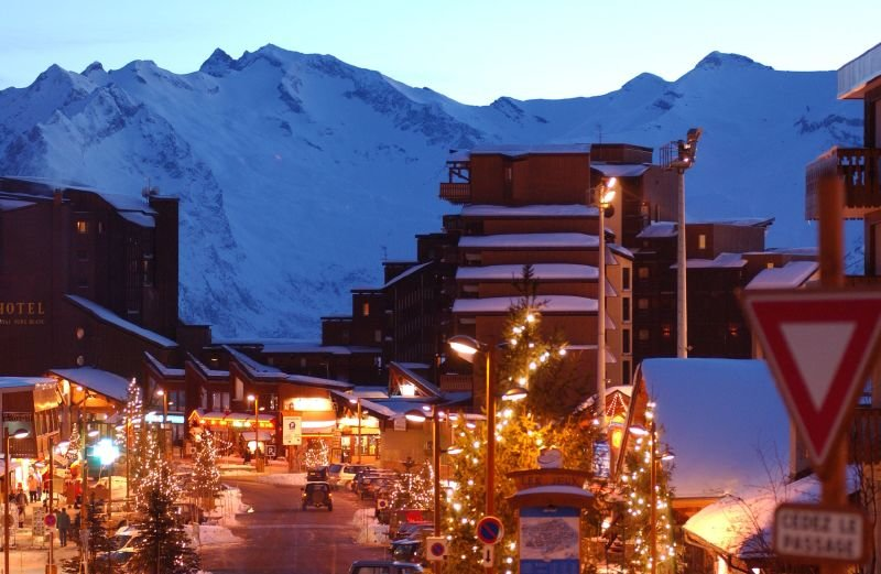 Alpe d'Huez town at night with street lights and mountains