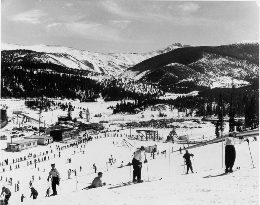 Skiers wear leather ski boots and wooden skis at Winter Park in its early years of the 1940s.