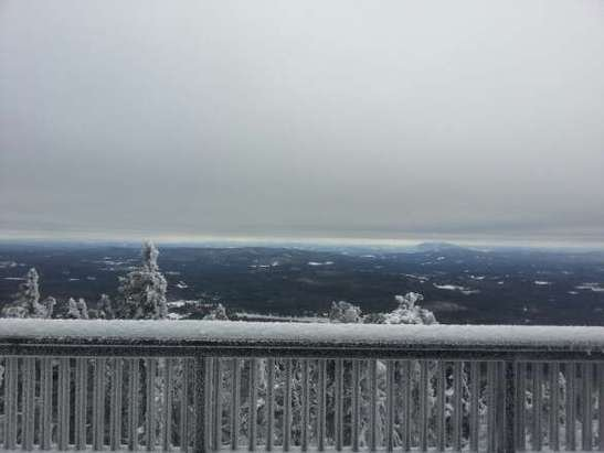 picturesque day at mt sunapee. can see okemo at , the top of mountain.  snow conditions were excellent.