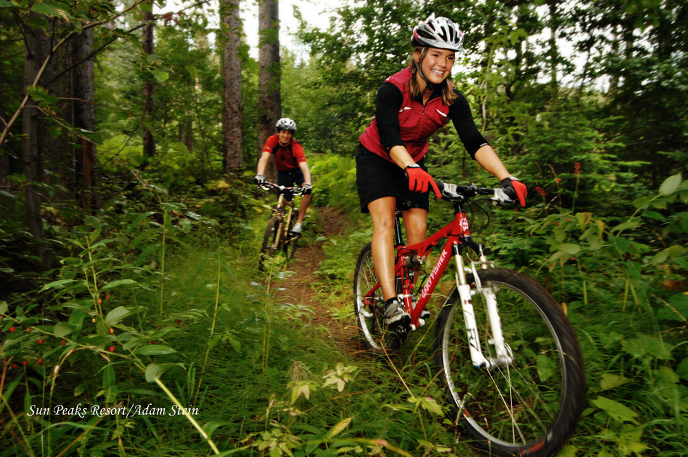 Mountain biking in woods in Sun Peaks