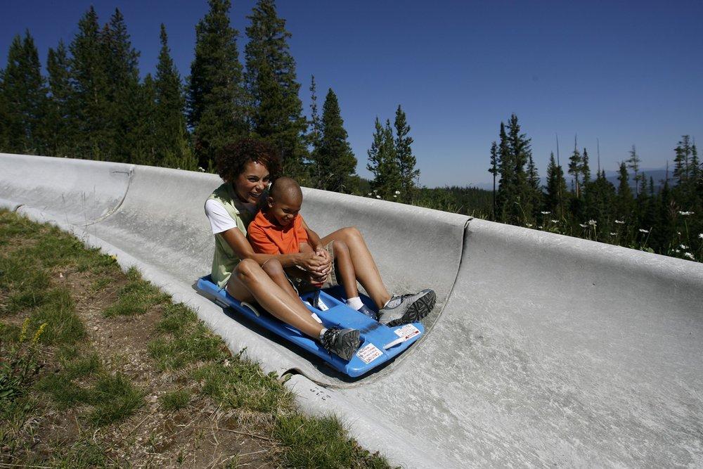 Riders on the Winter Park Alpine Slide.