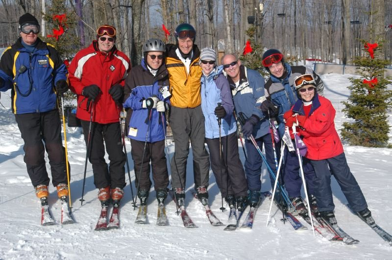 A group of skiers pose for a photo at Shanty Creek Resorts, Michigan