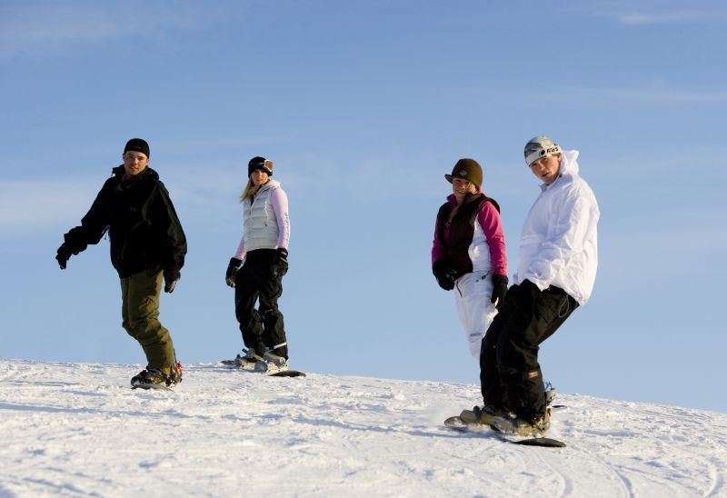 A group of snowboarders maneuver their way down the mountain, Shanty Creek Resorts, Michigan