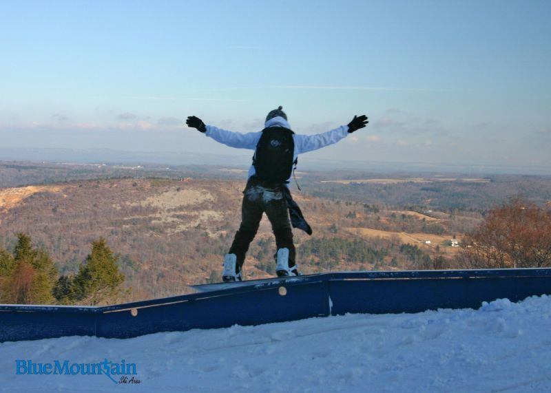 A snowboarder hits the rail in the terrain park in Blue Mountain, Pennsylvania