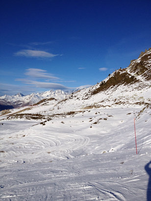 Les Arcs - As the report below said, ignore the crass comments. Arc 1800 side has 2 or 3 pistes closed but most are fine, some places icy but perfectly skiable. There are piste areas with stones but they're not everywhere. Best skiing is in the Arc 2000 bowl but not surprisingly it is busy at Plagnettrs and Arcabule.  - ©TJW's iPhone 4S