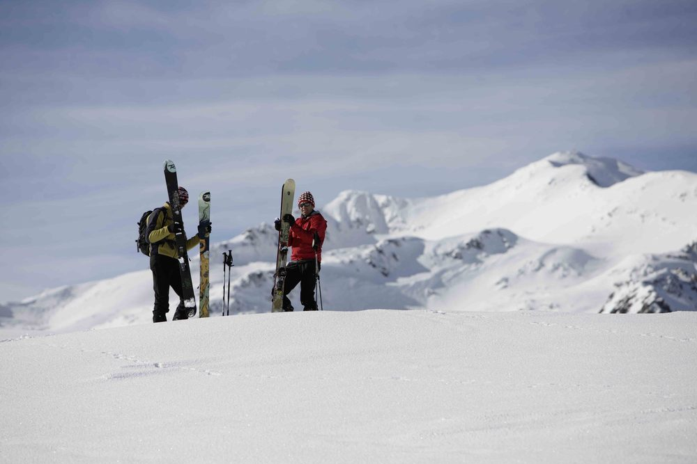 A pair of skiers ready to descend Val Senales, Italy.