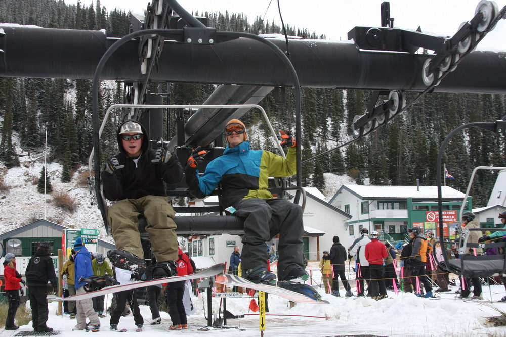 Snowboarders going up A-basin on opening day 2009.