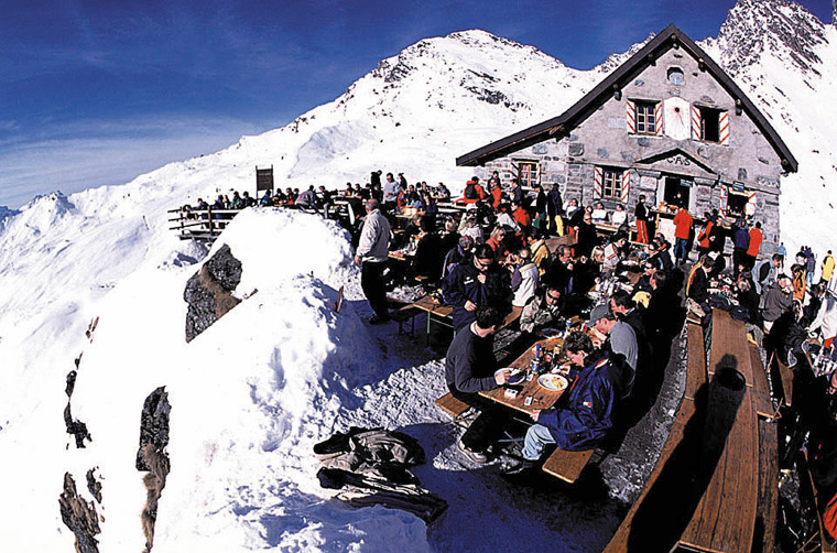 Skiers taking a break in Verbier, SUI