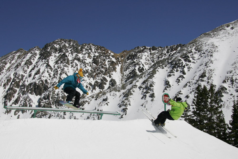 A skier and boarder at Arapahoe Basin CO CaseyDay