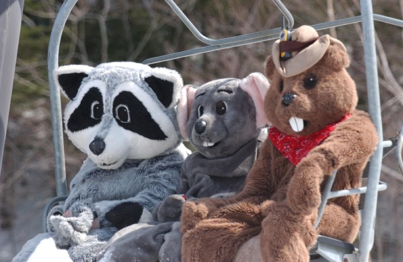 A group of mascots fill the chairlift at Ascutney Mountain Resort, Vermont