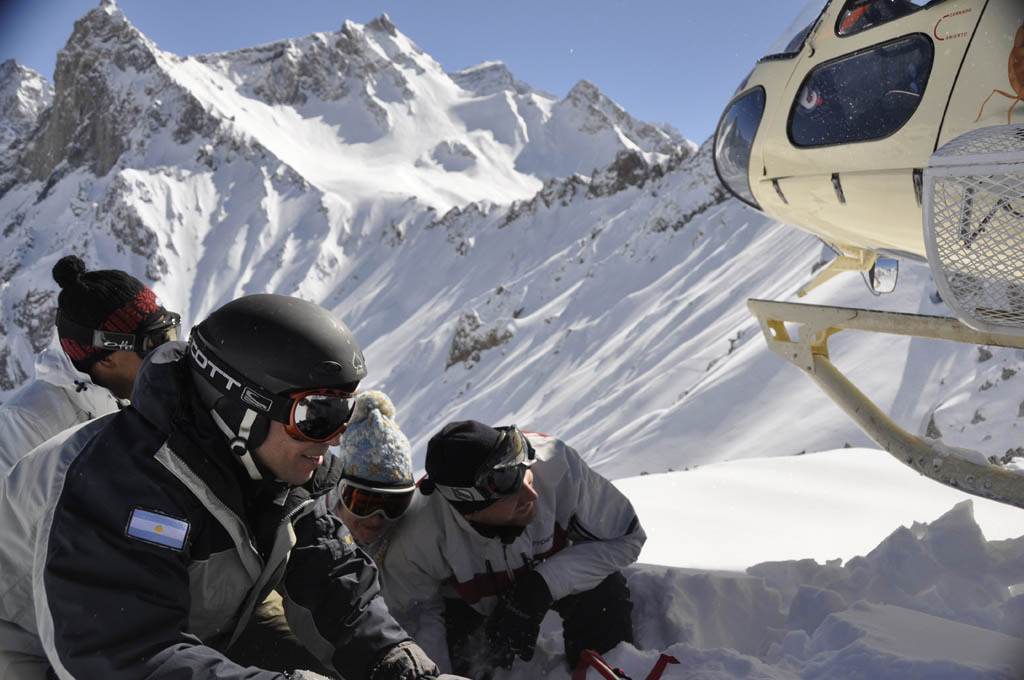 Heliskiers with their helicopter. Copyright: Andes Ski Tours
