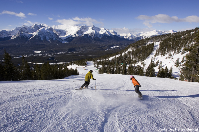 Skier and boarder on slopes of Lake Louise. Photo by Henry Georgi. Courtesy of Lake Louise.