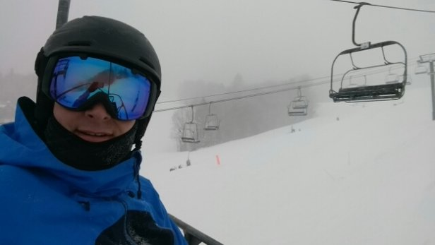 Okemo Mountain Resort - Tue 3/14 - The snow was very fine most of the day and is firm-ish, not the type of stuff you sink deep into, but it's pushy and not the wet type of firm.  Winds were howling in the top 1/5 of the mountain and blowing off the surface in places, but the lower 4/5 was all there.  Places like Solitude were deepest due to the lower place in the mountain.  South face looked untracked due to the snow and wind resurfacing the trails.  There were wind waves though in places.  Gotta give it to Okemo for keeping all but 1 regular lift going in blizzard conditions.  Jackson Gore bubble shut down due to mechanical issues in the afternoon.  Nearby another mountain only had one top lift yet again for a powder day.  Okemo is also opening an hour early tomorrow as a treat.  Big kudos for the effort, and that's why I keep coming back. - ©TheBrambster
