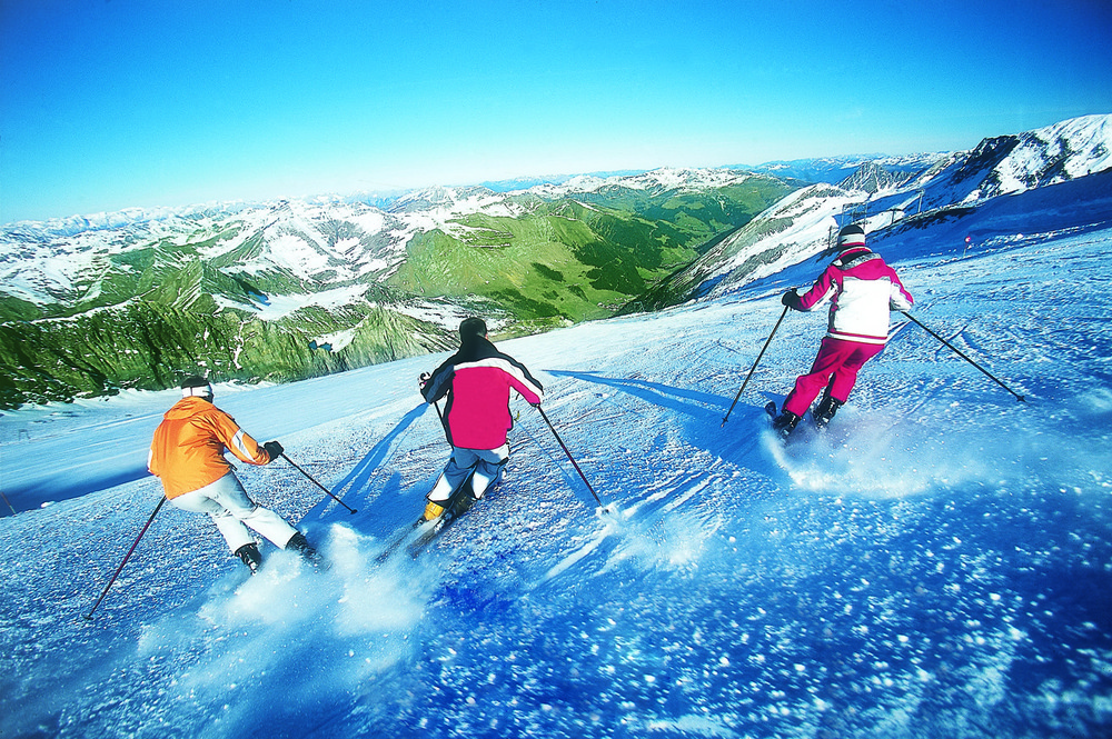 Summer skiers on the Tux glacier, Austria.