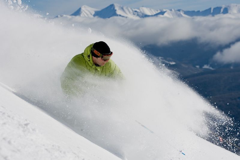 This skier gets a face full of powder in Breckenridge, Colorado