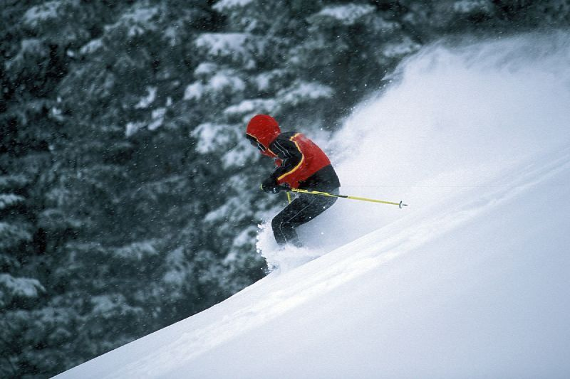 A skier finds powder in Snow Summit, California