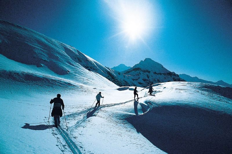 Crosscountry skiers traversing terrain in Flaine, FRA.