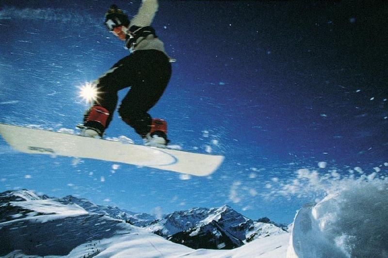 A snowboarder takes flight in Wildschönau, AUT.