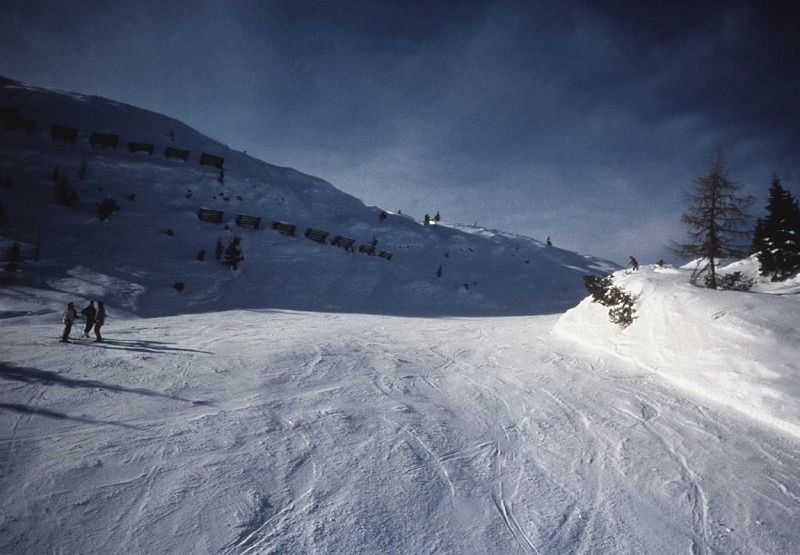 Wide open piste in Andalo with darkening sky