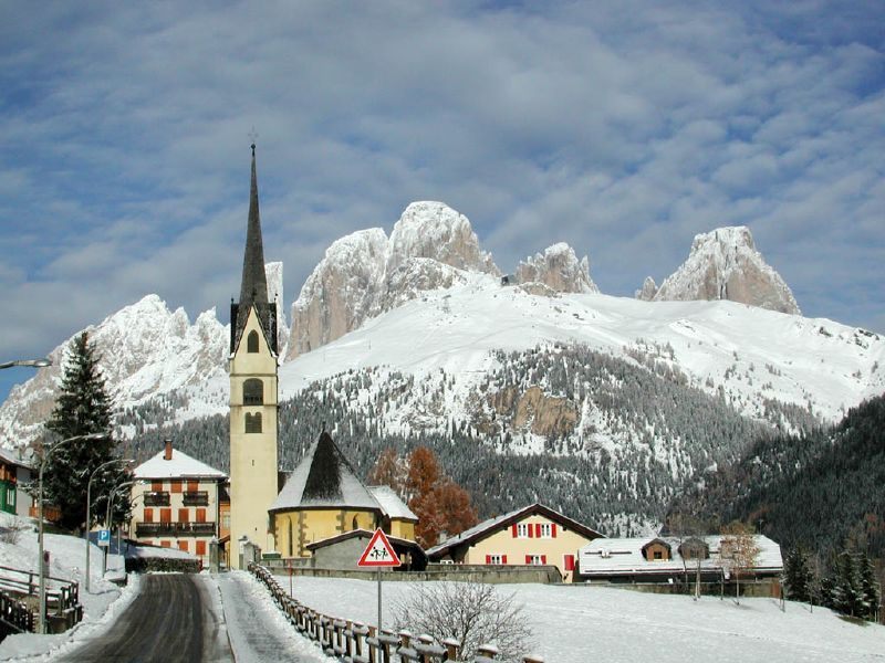 Alba village and church in the snow