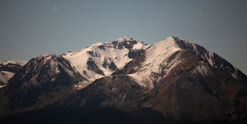 From the top of Aspen Mountain a full moon lit up snow-capped peaks
