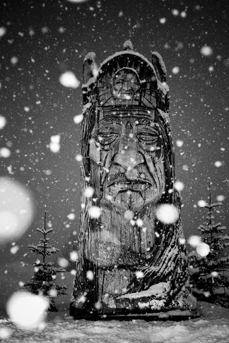 A statue in the town of Valdez during a snow storm.