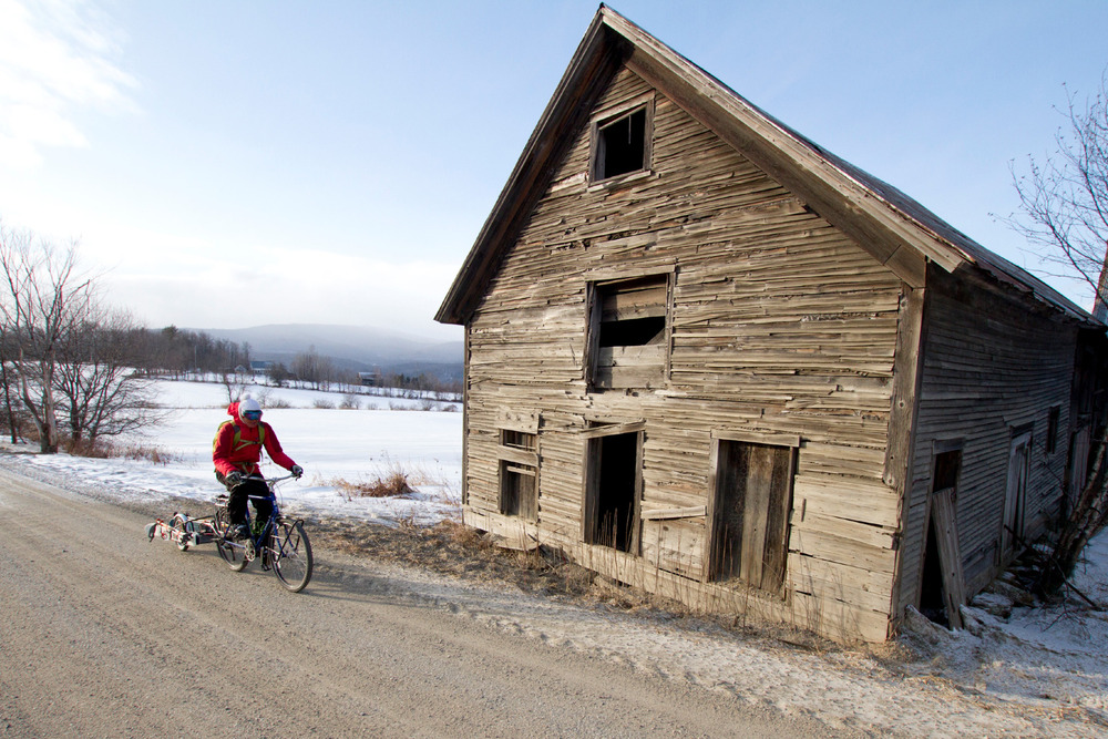 In mid-February, a rain storm followed by 50 degree temperatures left behind a respectable crust in the mountains. While giving the snowpack a few days to recover, the photographer and his wife made the most of some local, bike-accessed skiing on the sloped pastures of our neighbor's farm. - ©Ember Photography