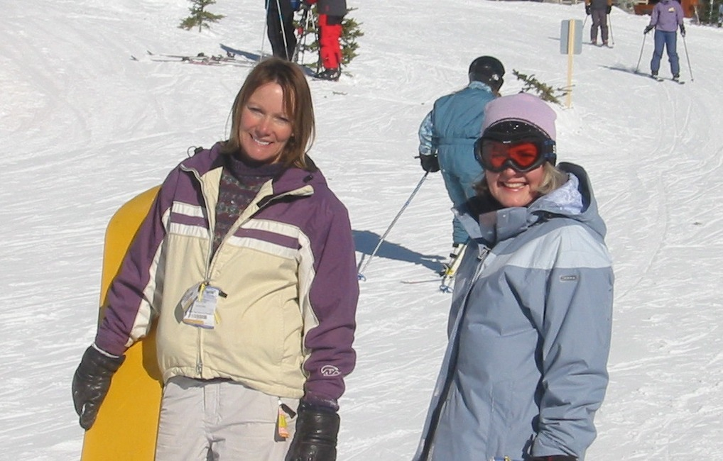 Two women smile at Big White sunshine. Photo by Peter Bulthuis/Flickr.