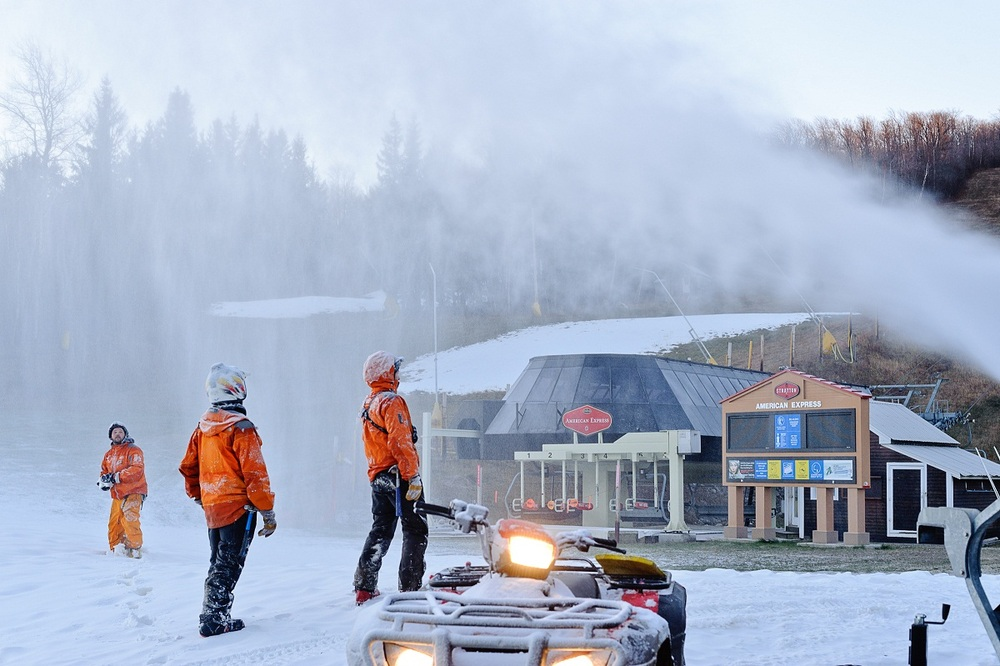 Snowmakers blow snow on the Stratton base area. Photo Courtesy of Stratton.