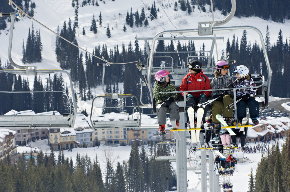 Sun Peaks Resort in BC:  Ski school class on lift. Photo by Adam Stein/Sun Peaks Resort