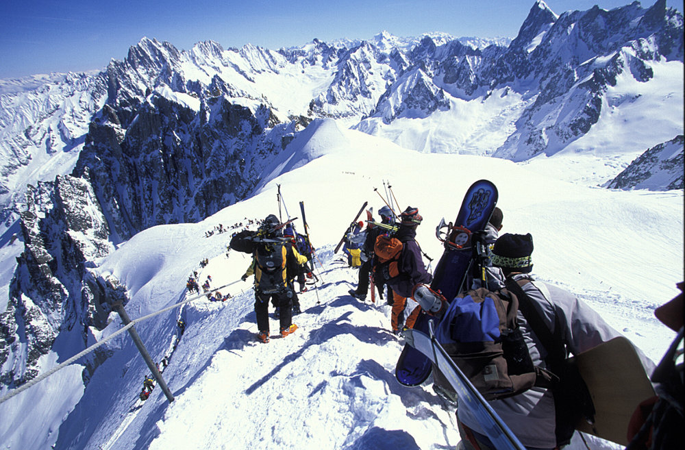 Walking down the ridge of the Aiguille du Midi at the start of the Valley Blanche, Chamonix