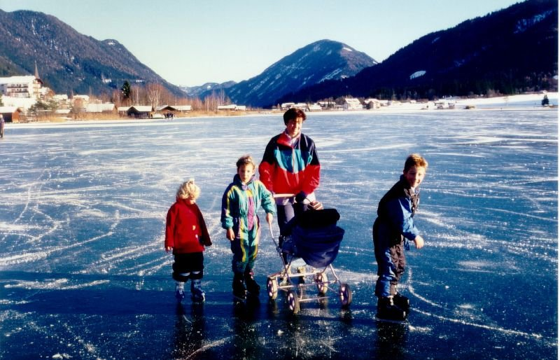 A family walking across a frozen lake in Nassfeld, AUT.